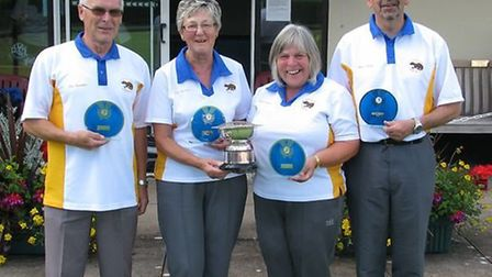 Eric and Joan Saunders together with Gail and Chris Hawke with the 'Jimmy Wyatt Trophy'