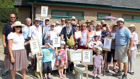 Residents and visitors to Branscombe gathered outside the public loos near the Sea Shanty to protest