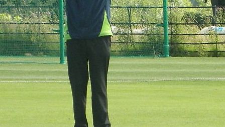 An umpire signals a six