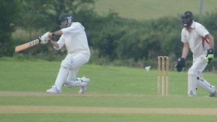 Phil Wright of Tipton St John puts bat to ball in the game against Tedburn St Mary