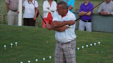 Sidmouth golfer Mark Thomas showing how it's done at a recent Golf Show.