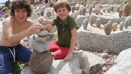 Brothers Sam and Josh Harwood-Wight have been busy creating a stone balancing spectacle on rocks by