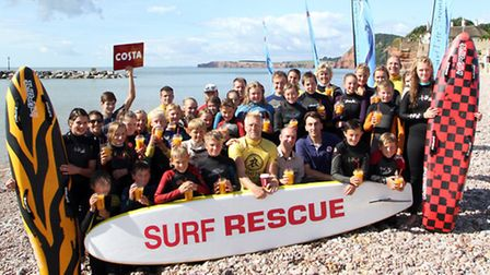 Sidmouth Surf Lifesaving Club welcome a donation from Sidmouth Costa to go towards their equipment.