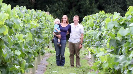 Andrew Simmons and Rebecca Russell with son Daniel Simmons and their dog Buster last year. Picture b