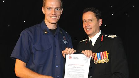 CM Jack Burgess receiving the award on behalf of Sidmouth Fire Station from Chief Fire Officer Lee H