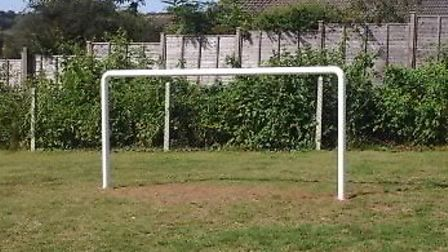 The goalpost will be removed because flying balls end up in the gardens behind.