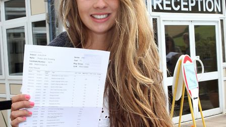 Sidmouth College GCSE student Poppy Snowling received five A star grades alongside her seven A and o