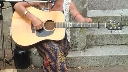 Tina Bridgman performing outside the Grosvenor Tea Rooms in Sidmouth during Folk Week.