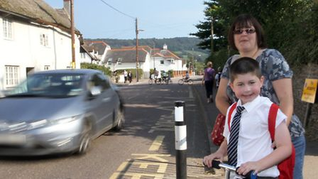 Emma Forbes with her son Charlie at the school crossing outside Sidmouth primary school. Ref shs 514