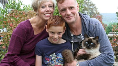 Hugo the cat back home with his family Becky,Ian and Jed Robson. Ref shs 7412-44-14TI Picture: Terry