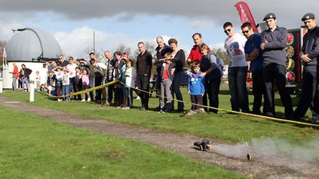 Sidmouth Science Festival 2014. A rocket car loses its wheels halfway through its journey. Ref shs 7