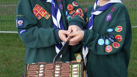 Adam and Matthew Dunford cut the cake at the Sidmouth Scouts field. Ref shs 7001-43-14TI. Picture: T