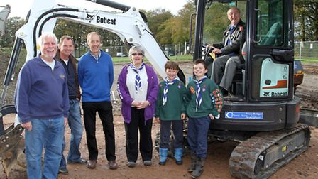John Hollick at the controls of a digger at Sidmouth Scouts field for the cutting of the turf. Ref s