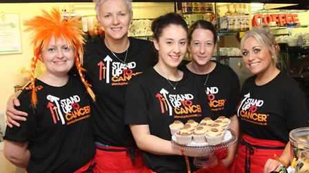 Staff at taste helped boost funds by selling cakes. Ref shs 9061-42-14SH Picture: Simon Horn