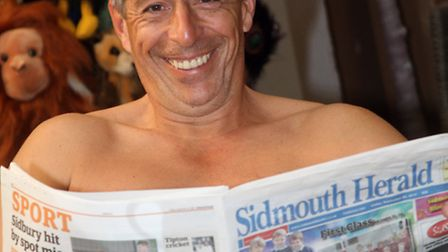 The Sidmouth Herald helps to keep Ian Barlows dignity during a charity nude calendar shoot. Ref shs