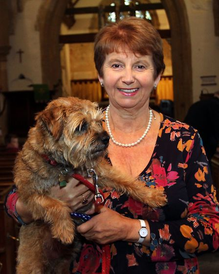 Penny Lamb is pictured with her Border terrier Rufus at the Sidbury Tingle Service. Ref shs 8706-42-