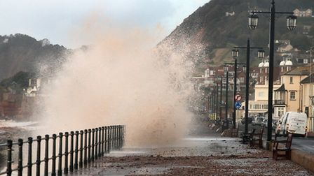 Big waves overtop the promenade at Sidmouth on Thursday morning. Ref shs 6904-41-14AW. Picture: Alex