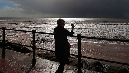Ian Williams captured captured this lady looking out from Sidmouth at the approaching storm clouds