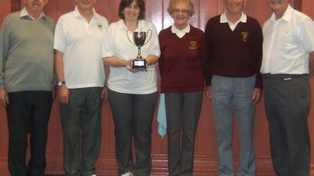 Sidbury short mat bowls team; (left to right); Ron Berry, Ottery chairman, Eric and Caroline Pavey,