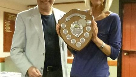 Jane Corry receives the Sidmouth Tennis Club mixed doubles winners trophy from club chairman Peter F
