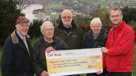 National Trust's Head Ranger for East Devon Peter Blyth is pictured receiving a cheque for £29,700 f