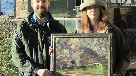 Emma Bowring presenting the painting to DWT at the Trust''s Cricklepit Mill HQ