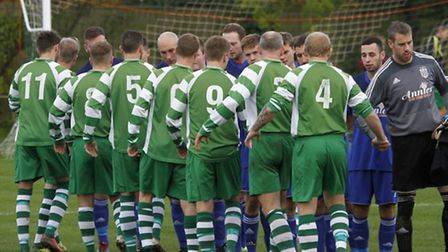 Sidmouth Town welcome Totnes and Dartington at the start of the match. Ref shsp 8403-47-14TI Picture