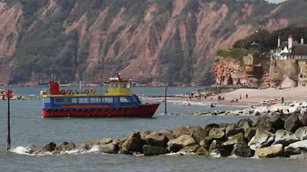 A Stuart Line cruise boat prepares to dock at the beach in Sidmouth. Photo by Simon Horn. Ref shs 50