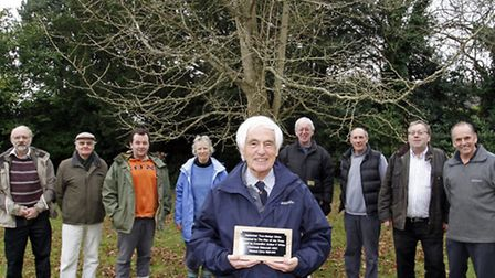 Graham White with the replacement plaque for the Ginkgo Biloba tree at the Knowle. Ref shs 0801-03-1