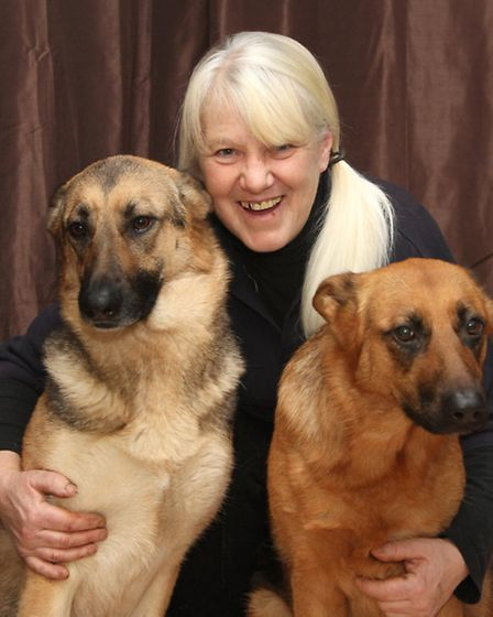 Denise Davy with her six year old German Shepherd Missie (right) who has won a Canine Hero Award and
