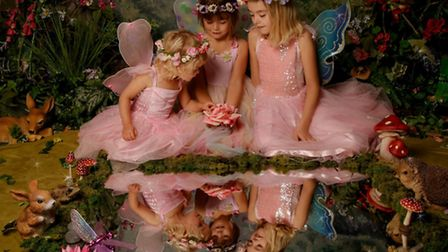 The Woodland sisters are enthralled in their fairy world in their winning photo.