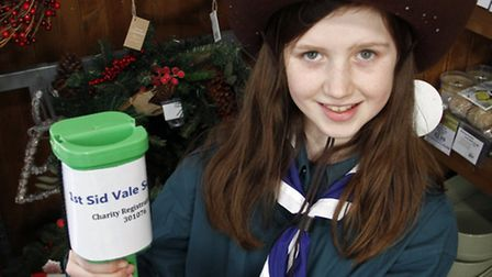1st Sid Vale Scout Sofia Abrahams collecting at the Waitrose christmas car parking event. Ref shs 04