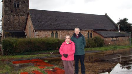 Revd Mark Ward and church council member Audrey Callis standing on the site of the former Newton Pop
