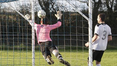 The Sidbury keeper makes an early save against Beer. Ref shsp 0488-53-14TI. Picture: Terry Ife
