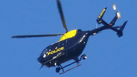 The Police helicopter is pictured flying over Sidmouth at the weekend. Ref shs 0278-04-15SH. Photo S