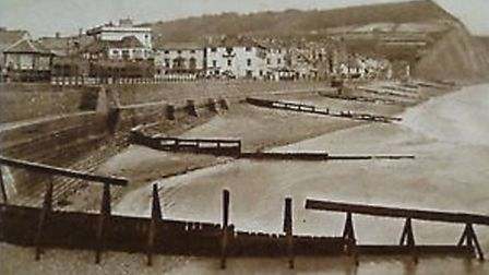 A postcard of the old wooden groynes shared on the Sidmouth Photos Facebook group