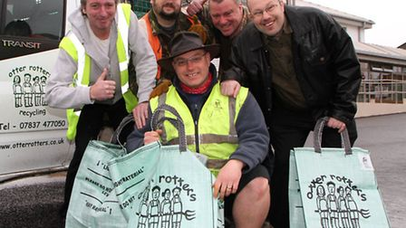 Otter Rotter recycling collection operative, Rufus Duffin (centre) who won a recycling award, with h