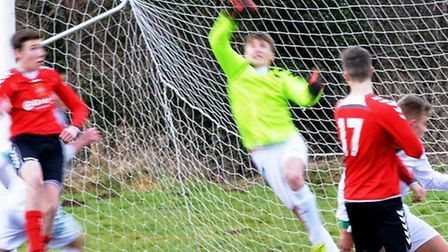 Goalkeeper Fin Marks makes a finger tip save in the Sidmouth Under-16s 6-1 win at Cullompton