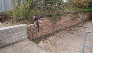 Damaged flood wall in Ottery