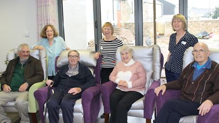 Patients, Hospiscare staff and volunteers relaxing in the comfy, homely lounge.