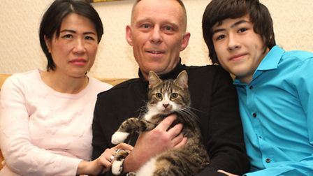 Mow Mow is pictured in the arms of Paul with his wife Chie and their son Li Xian at their Sidford ho