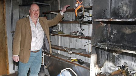 Paul Matthews in his neighbours fire damaged garage. Ref shs 2076-06-15TI. Picture: Terry Ife