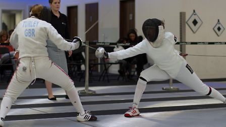 Jessica Gundry (on right) landing a hit on her way to a 15-4 victory in the U23 Womens Epee British