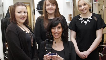 Sarah and her team with their award at Element Hairdressers in Sidmouth. Ref shs 2870-07-15TI. Pictu