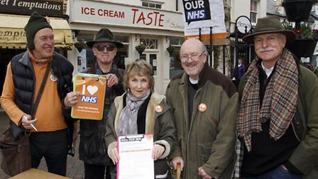 Robert Crick,Mike Ferrard,Deirdre and Terry Hounsom and Simon Papworth in Sidmouth market square. Re