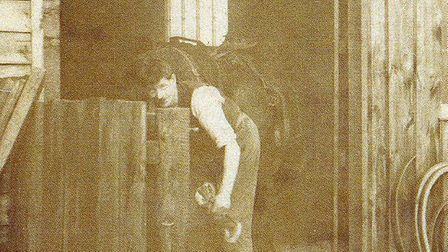 Peter's father William in his blacksmith shop next to the village hall.