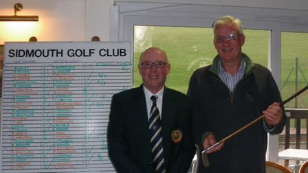 Sidmouth club captain John Barnard with victorious East Devonians captain, Lester Willmingto