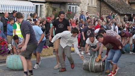 Barrel rolling as part of Beer Regatta Week. Picture by Alex Walton. Ref shb 1105-33-14AW. To order