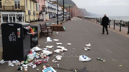 The district council's 'big belly' bins overflowed on Sidmouth seafront during the bank holiday week