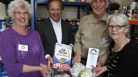 Hugo Swire at the food bank in Sidmouth with Ian Skinner and volunteers Renee Forth and Margaret New